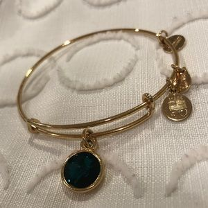 Gold Alex and ani bracelet with emerald